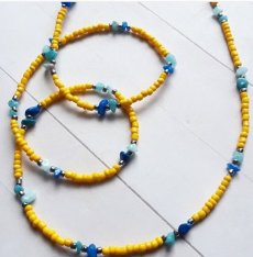 Request a custom order and have something made just for you. Yellow African Waist Beads w/ Gem Accents